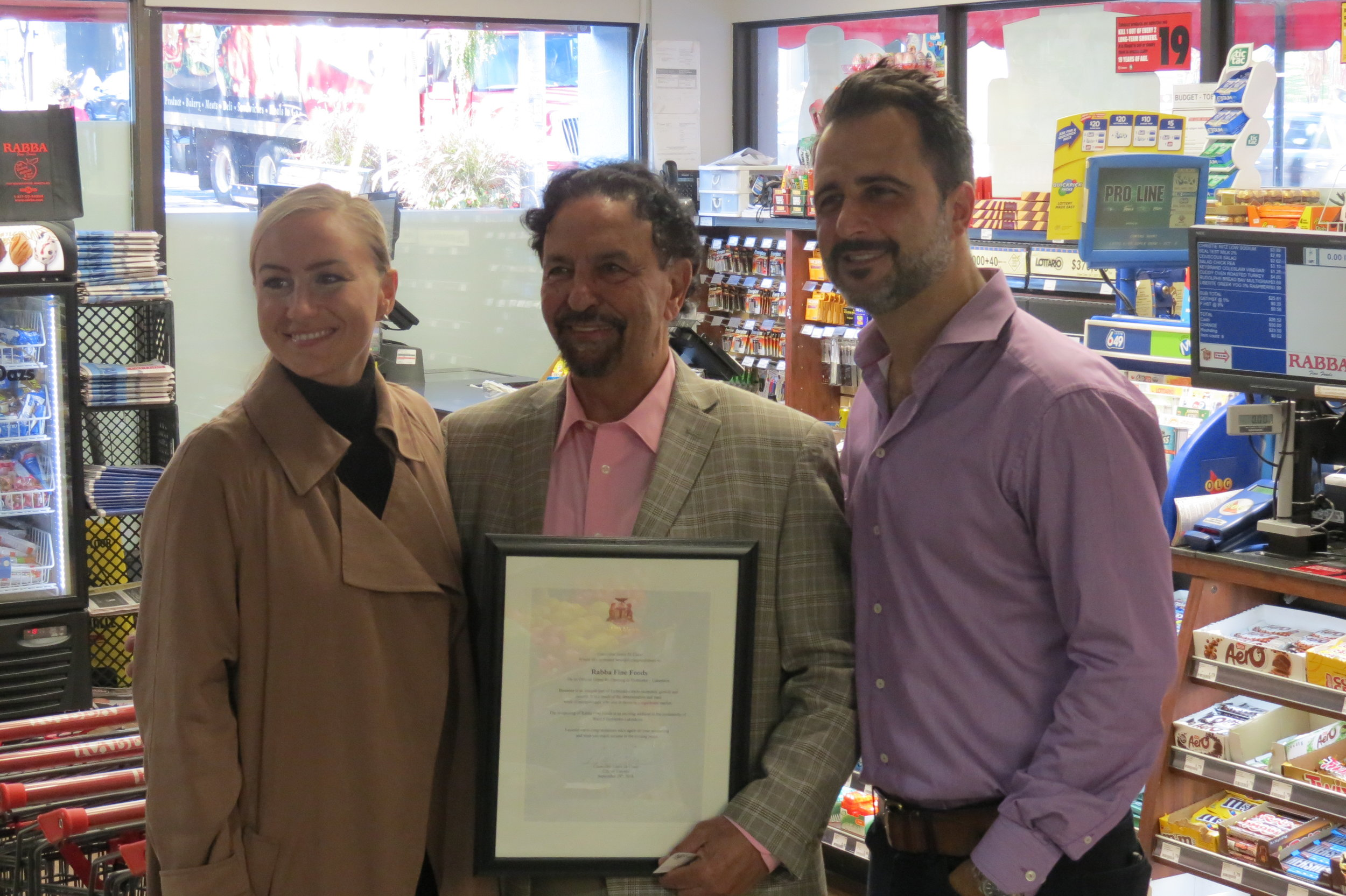 MPP Etobicoke Centre Kinga Surma and Ward 5 Councillor Justin Di Ciano, presented a Congratulatory Scroll to Rabba Fine Foods founder Jack Rabba, during the grand re-opening at the 4869 Dundas St W location.