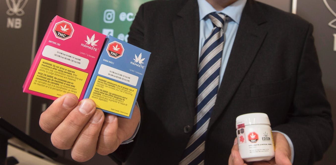 Brian Harriman, Cannabis NB president and CEO, displays some cannabis products at a Cannabis NB retail store in Fredericton, N.B., on Tuesday October 16, 2018. THE CANADIAN PRESS/Stephen MacGillivray