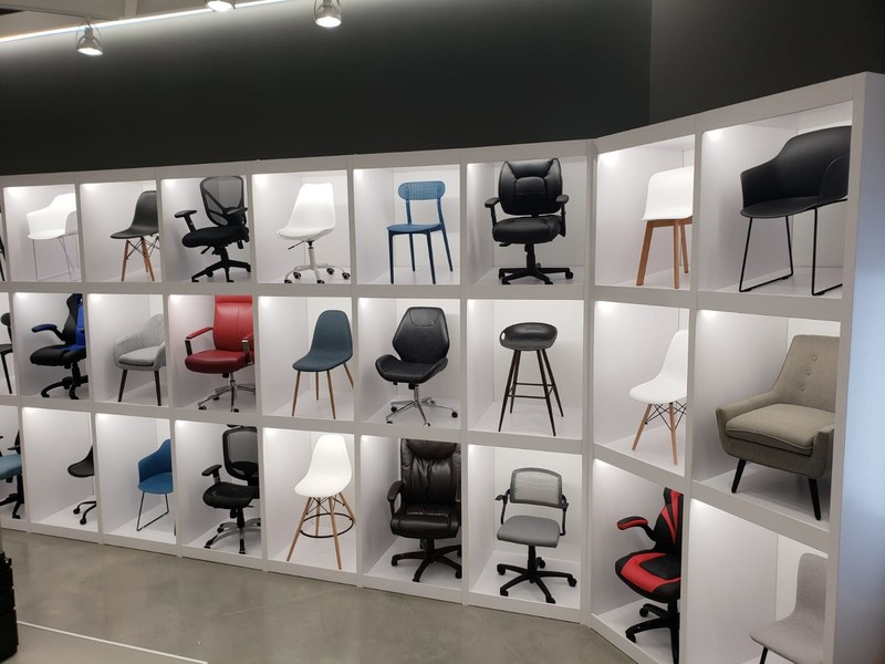 Chair wall display at the new concept at Bureau en Gros store in Kirkland, Quebec. Photo: Newswire/Staples