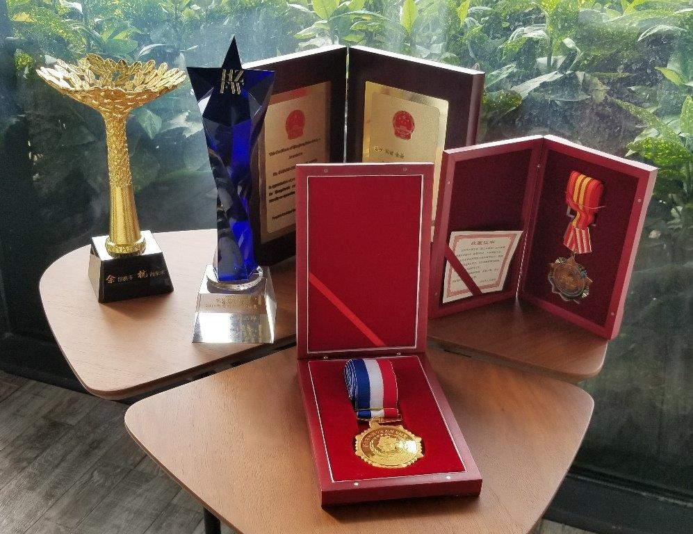 Clockwise: 2018 Yuhang District Talent Award, Hangzhou Designer of the Year Award from Fashion Week, Certificate and Medal of Qianjing Friendship, Zhejiang West Lake Friendship Award for Foreign Experts – This is the highest award a foreigner can receive in Industry in Hangzhou