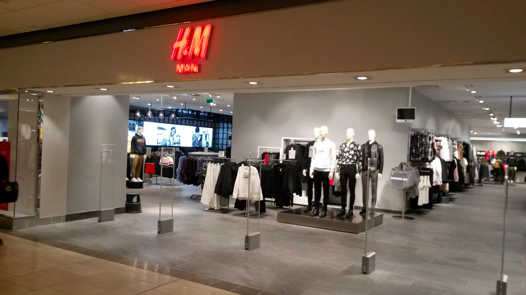 New H&M Man on the concourse/mall level of  CF Pacific Centre. Escalators to be (re) installed. Photo: 'Granville Street' via Twitter.