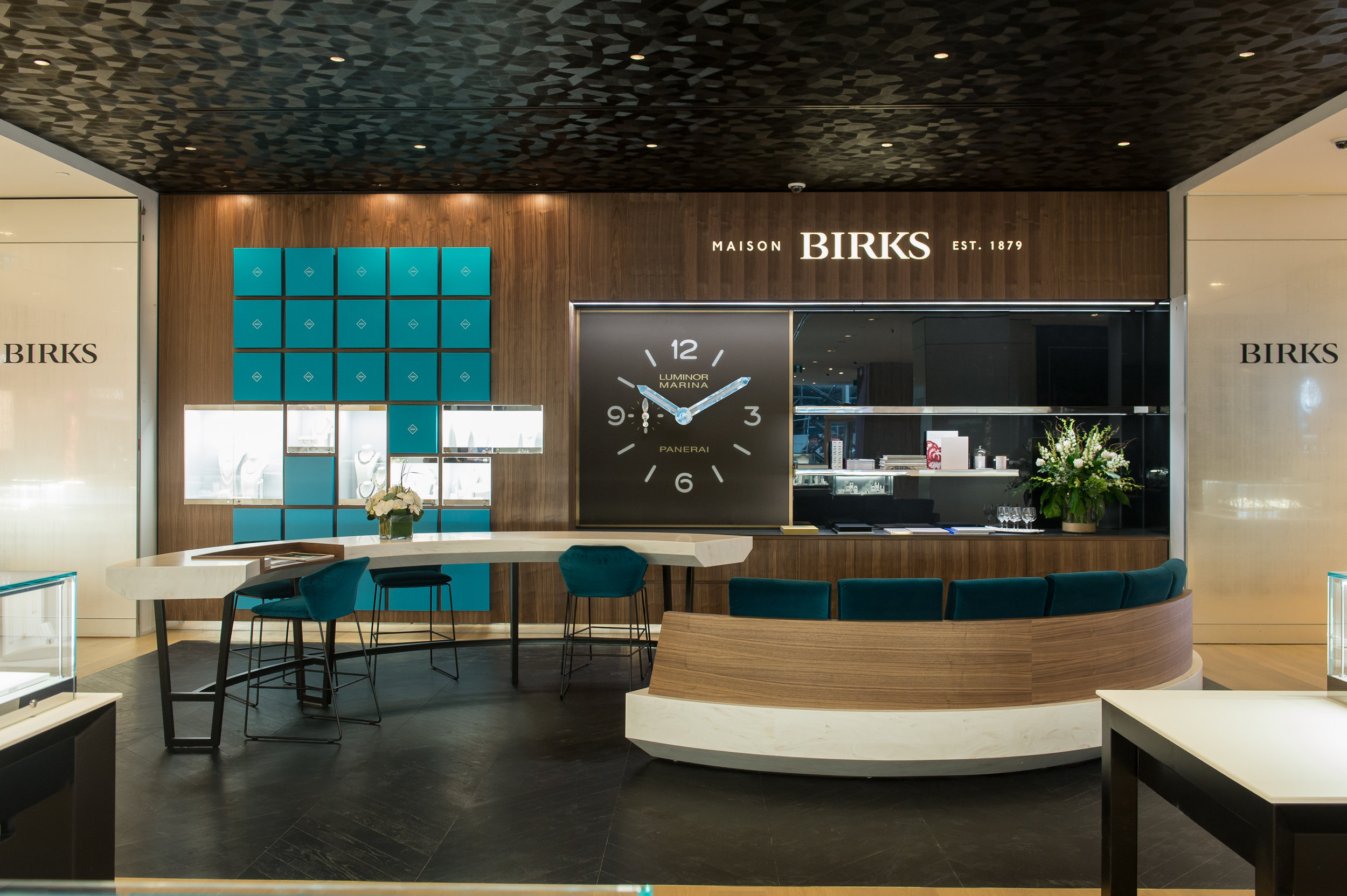 Lounge and service area, with seating and an espresso machine. PHOTO: MAISON BIRKS