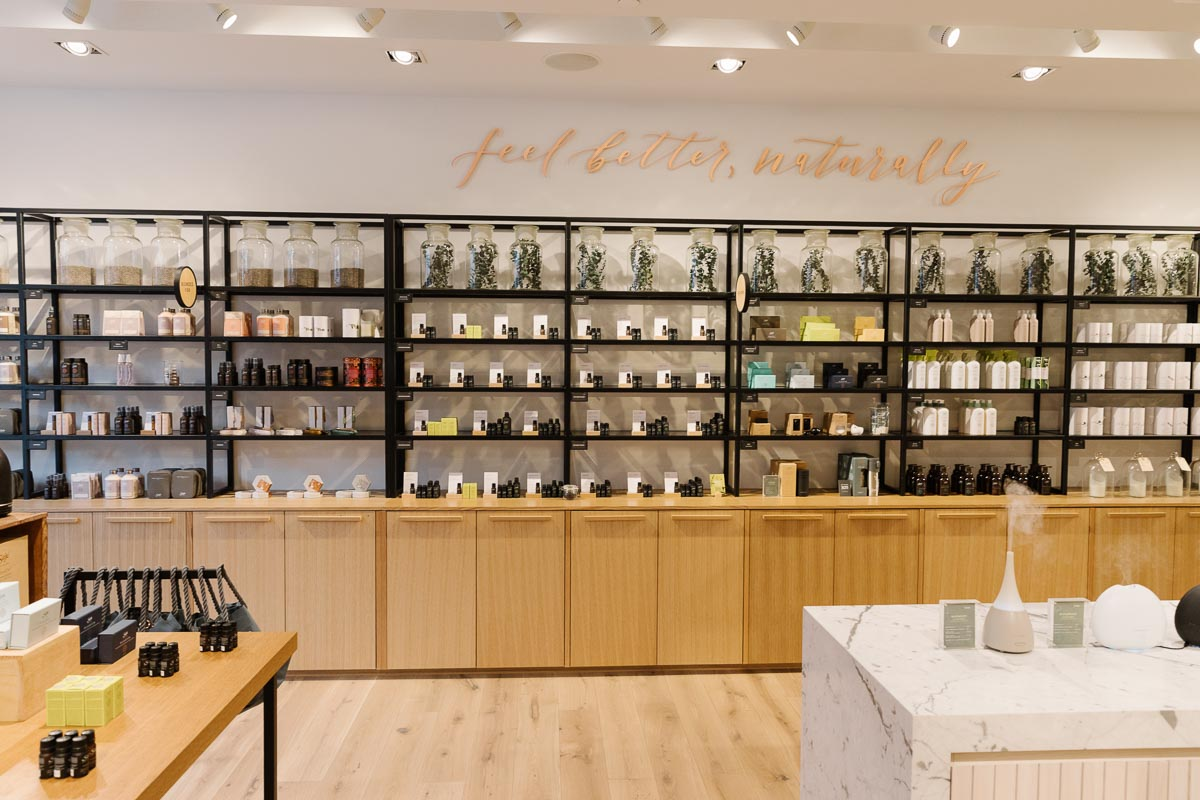 Displays in the CF Richmond Centre store, featuring natural wood, metal and marble. Fixtures and PHOTO by:    PEREGRINE