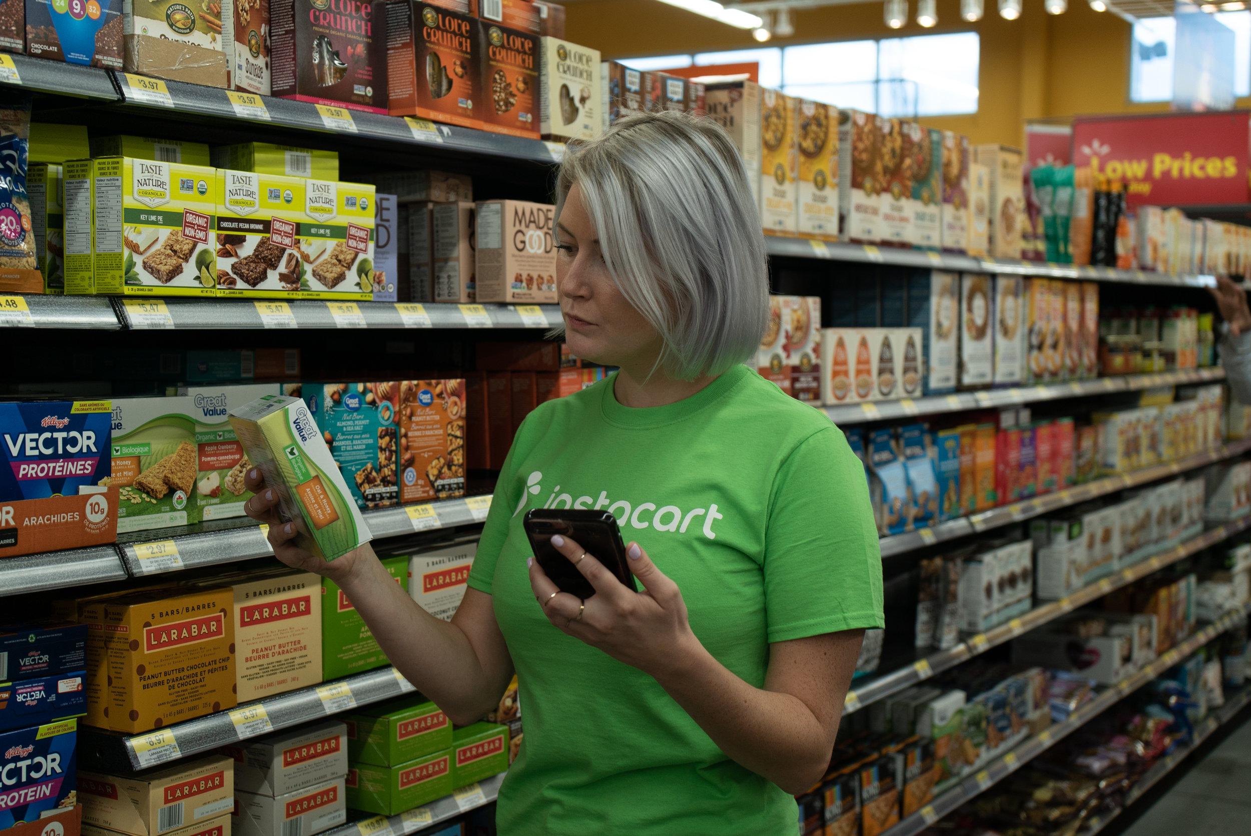 instacart shopper selecting groceries for a client at walmart photo: instacart via walmart