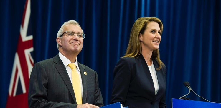 VIC FEDELI, ONTARIO'S FINANCE MINISTER, AND ATTORNEY GENERAL CAROLINE MULRONEY TALK TO THE MEDIA AFTER ANNOUNCING ONTARIO'S CANNABIS RETAIL MODEL ON AUG. 13. THE CANADIAN PRESS/CHRISTOPHER KATSAROV