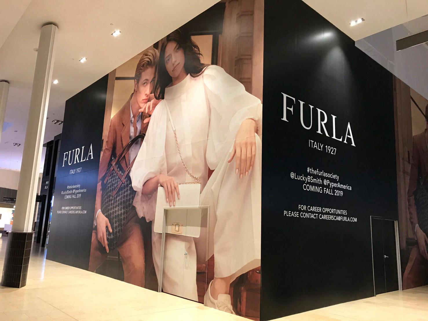 CONSTRUCTION HOARDING AT FURLA'S NEW YORKDALE LOCATION. Photo: Jeff Berkowitz