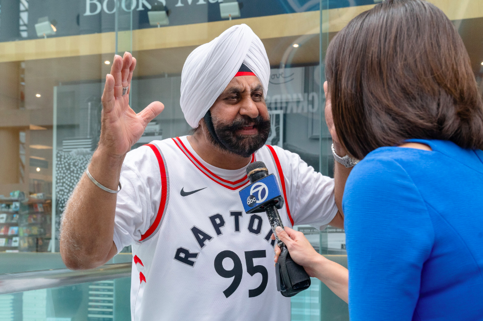 Raptors superfan Nav Bhatia speaks to a reporter.