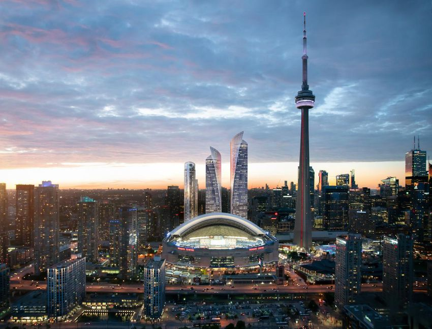 Nighttime view of Toronto's skyline with the new 'Union Park' rising behind the Rogers Place facility. Image: Oxford Properties.