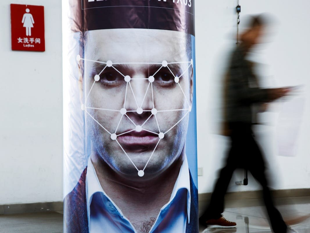 a poster simulating facial-recognition software at the Security China 2018 exhibition on public safety and security in Beijing, China. PHOTO: BUSINESS INSIDER