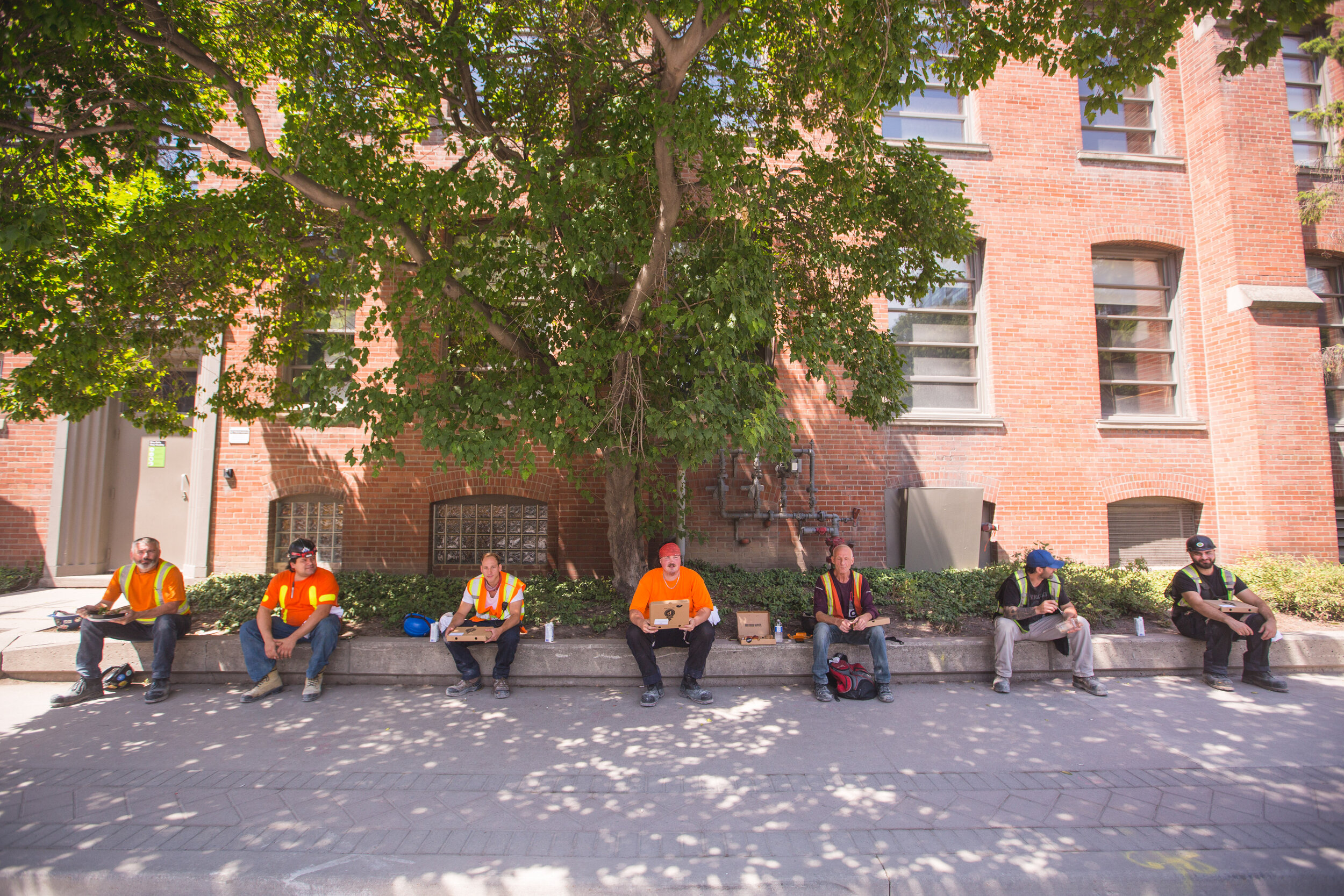 CONSTRUCTION WORKERS ENJOYING 'THE LUNCHBOX CHALLENGE' PROGRAM. PHOTO: RIOCAN
