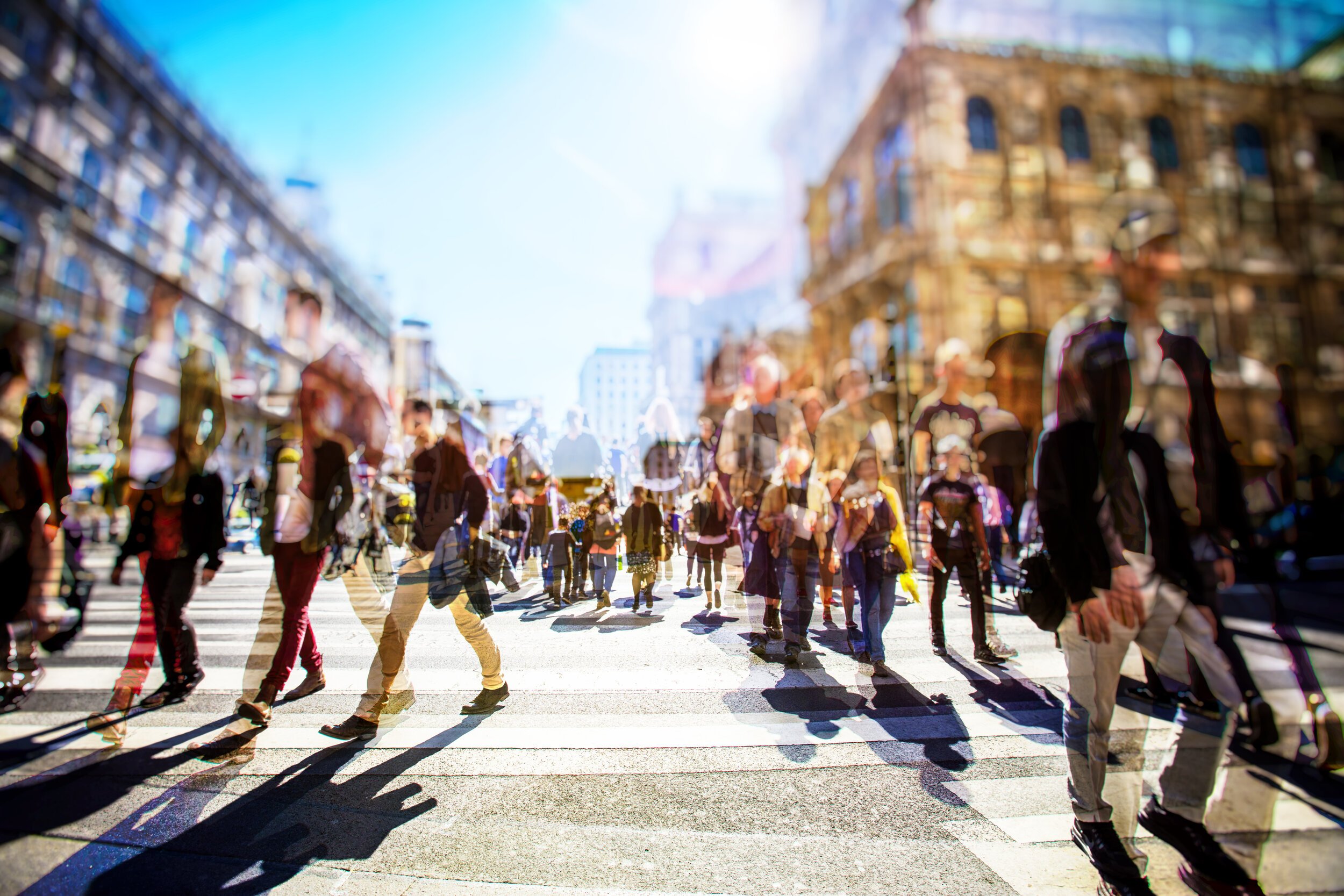 blurred image of shoppers moving in different directions at intersection