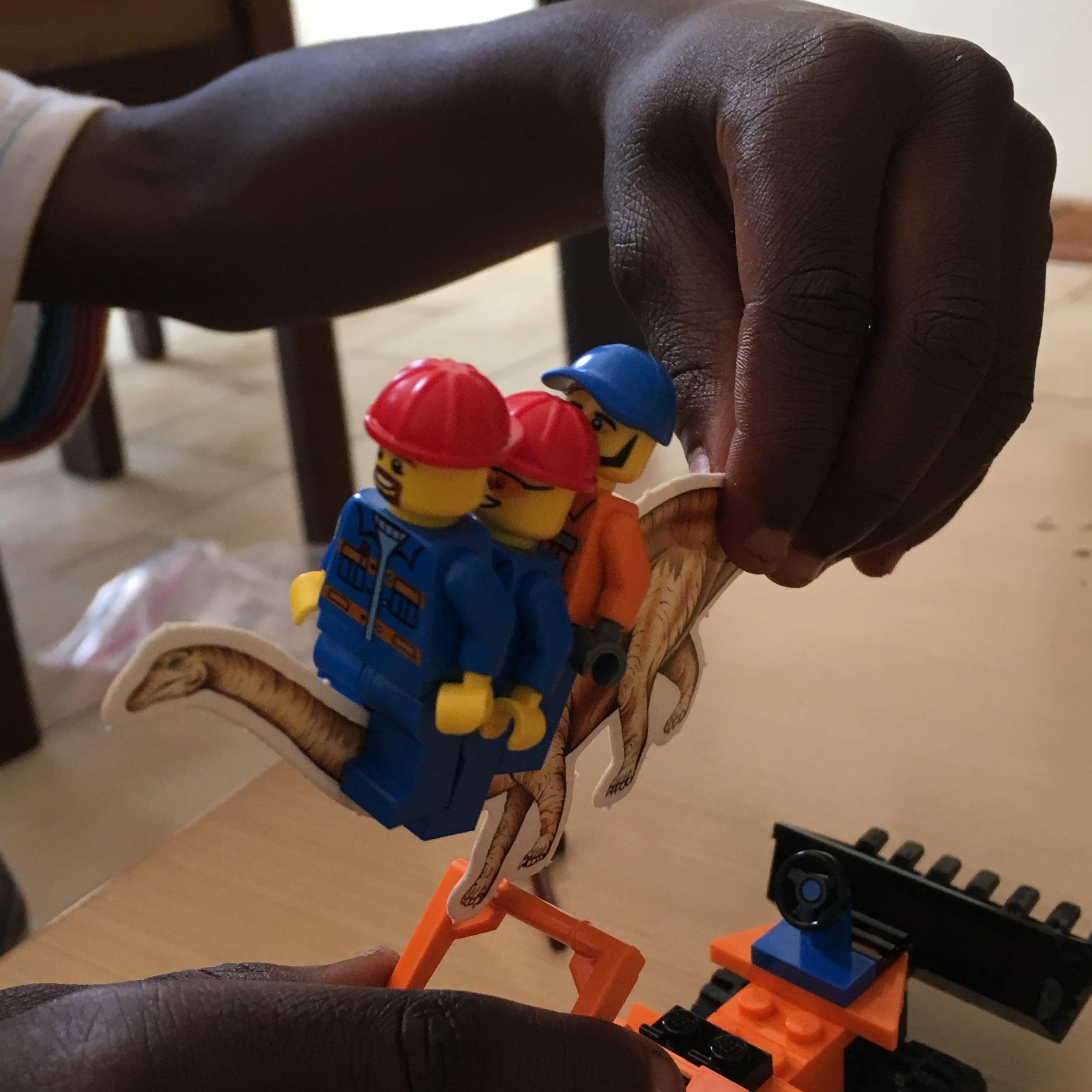 Lego construction men riding helpful dinosaurs—naturally.