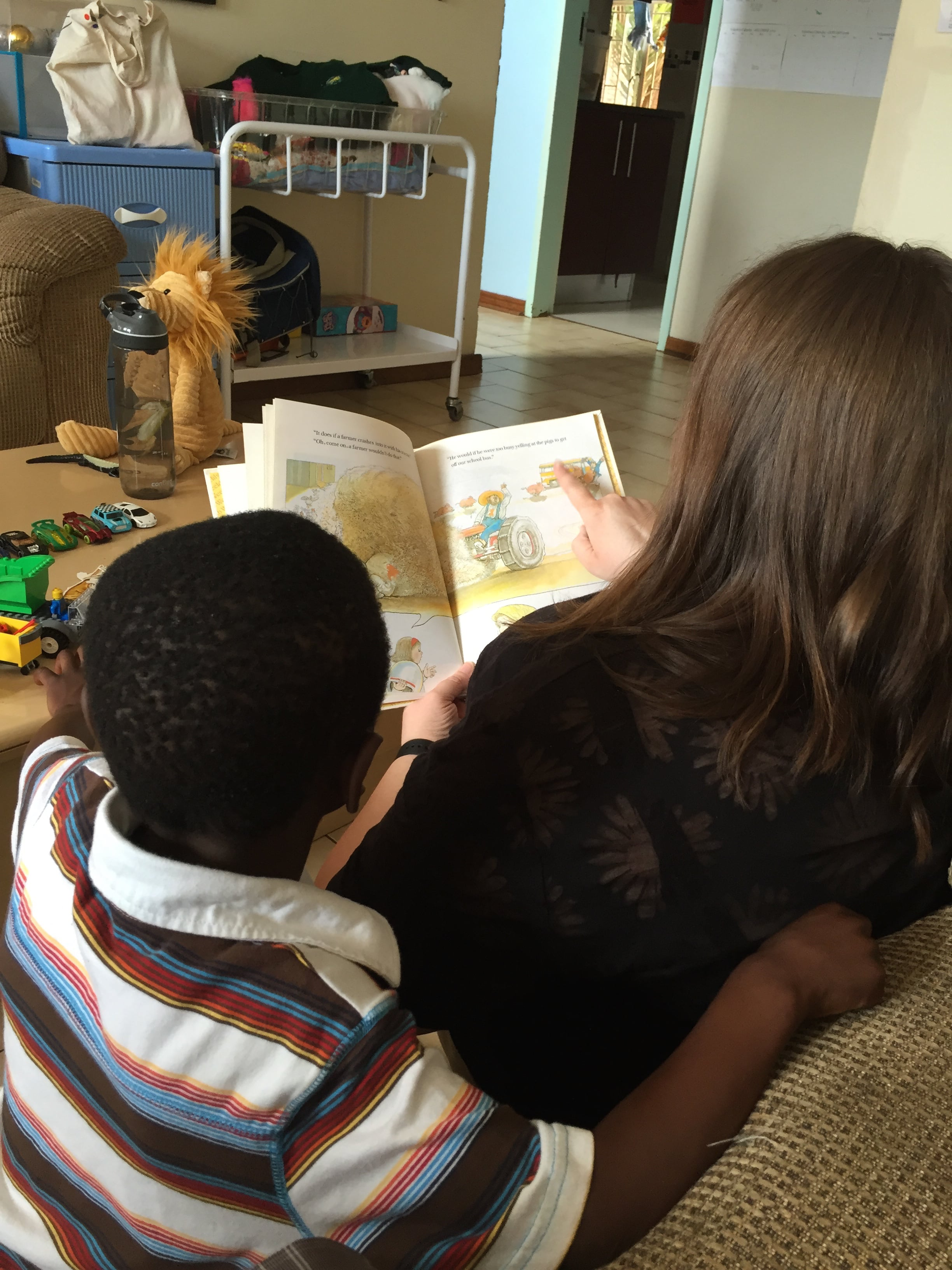 Story time together. I love this picture.