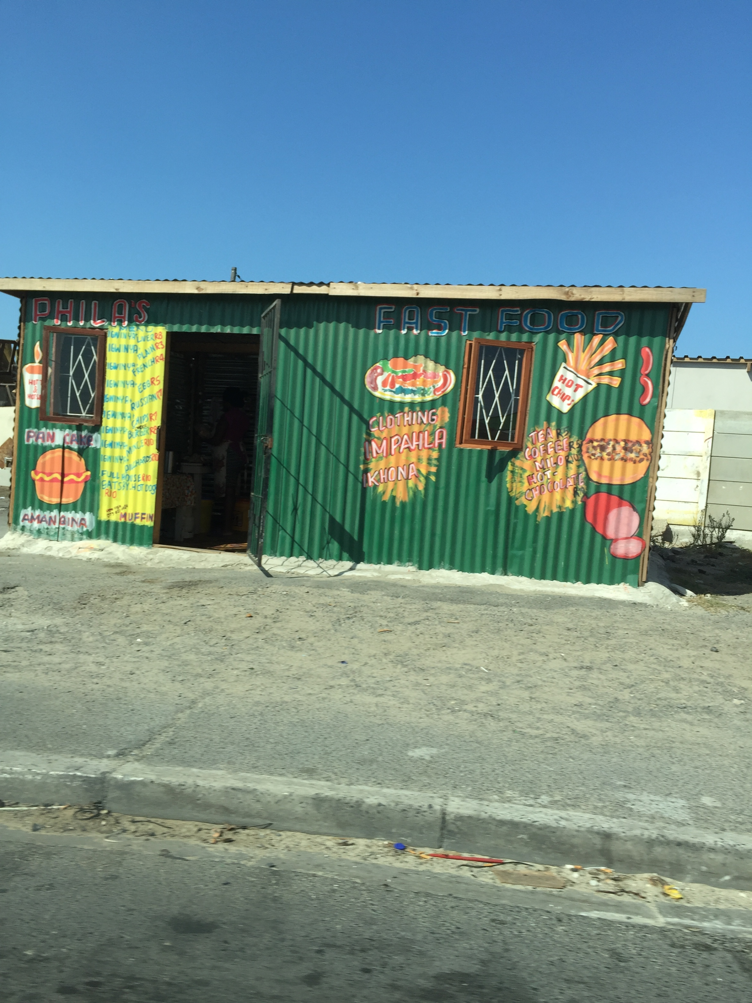 A lot of the shipping crates have been turned into shops with colorful murals painted on them advertising what's inside.