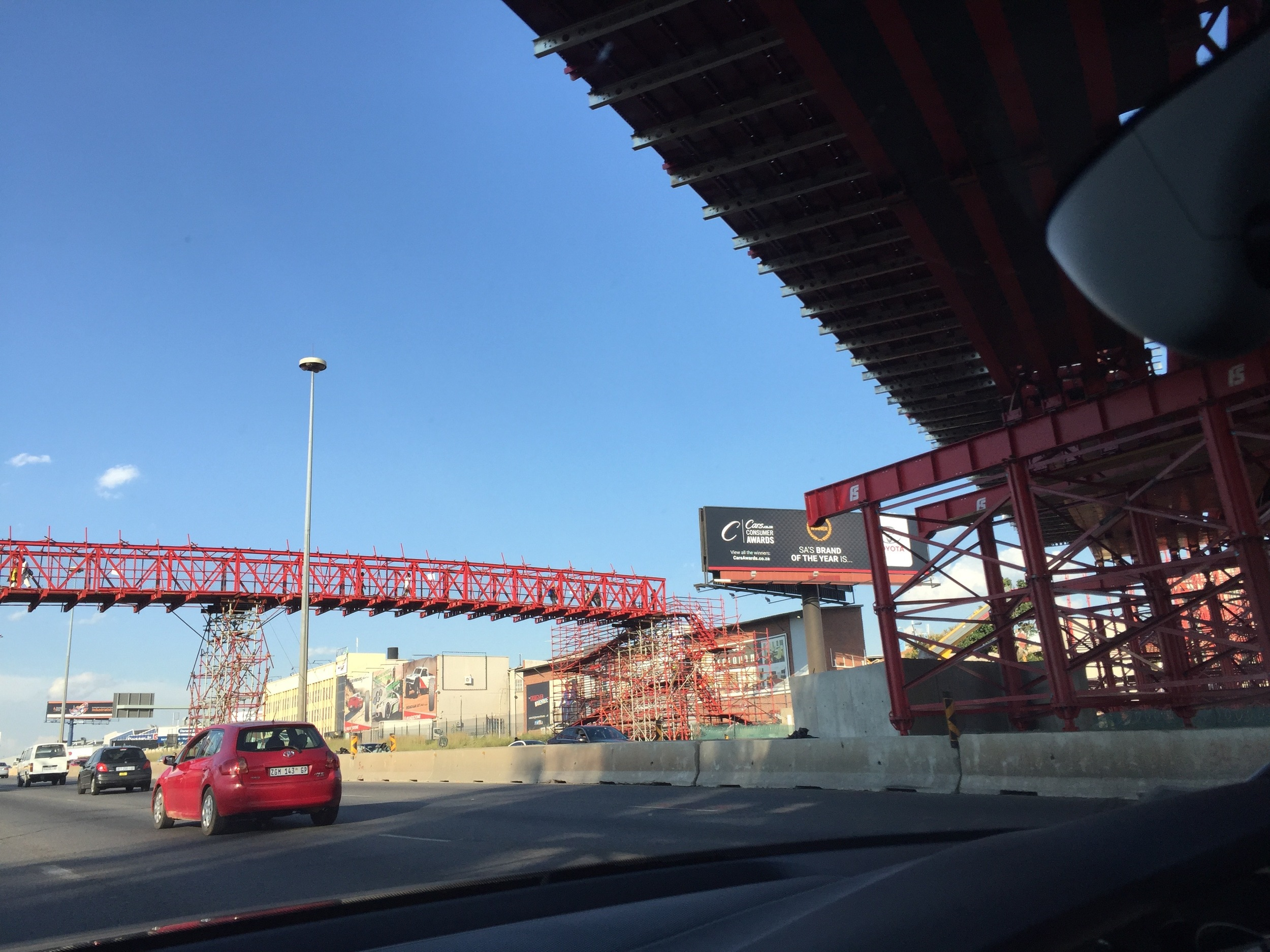 A walkway bridge made out of scaffolding. Eeek!!!