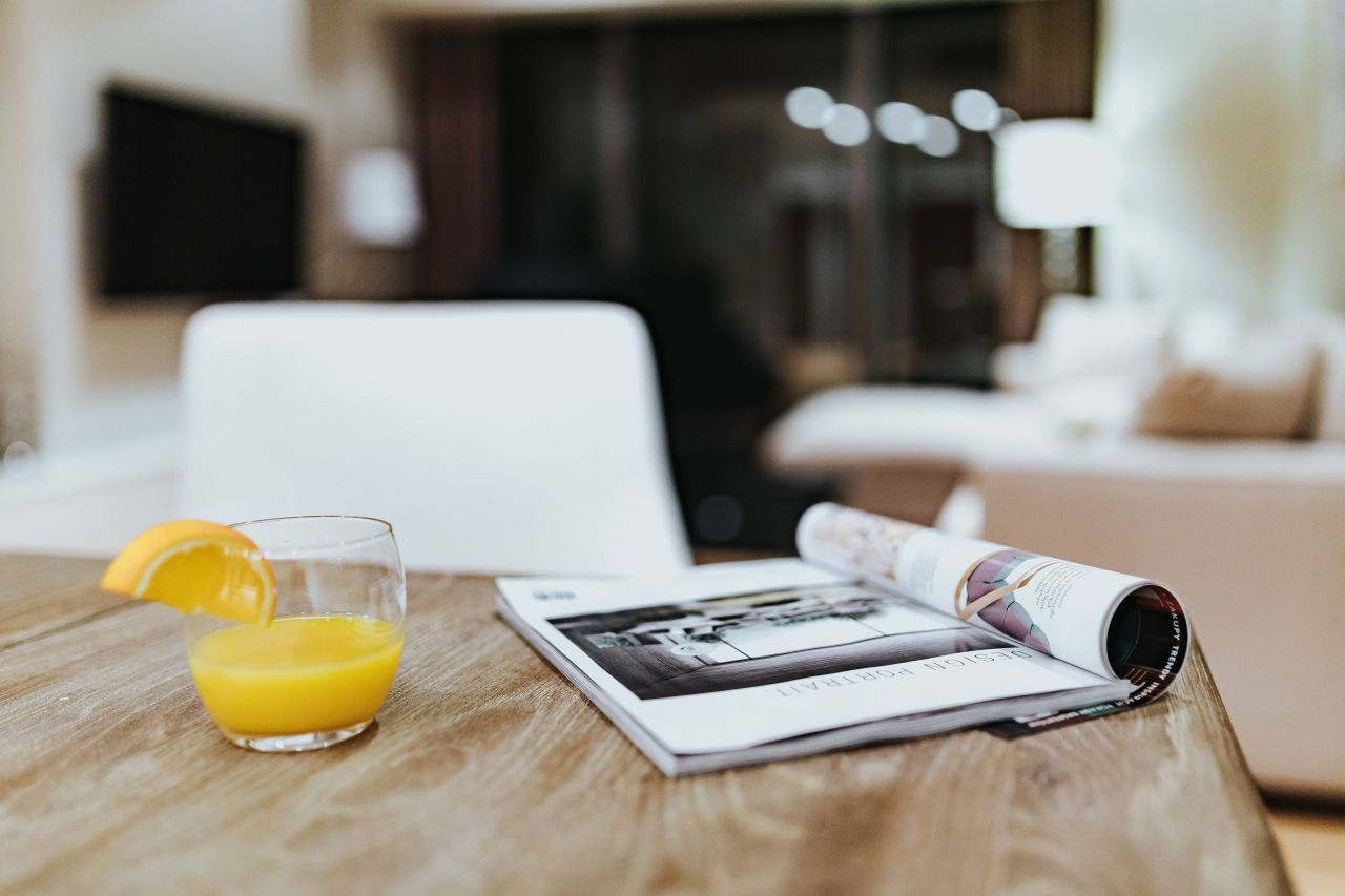 kaboompics_Magazine with a fresh juice on a table.jpg