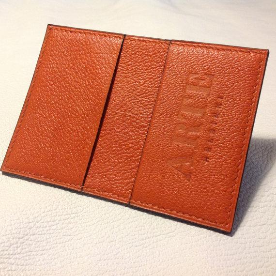Orange chevre wallet.