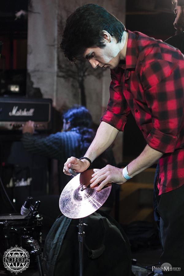 "Defkalion Dimos, the band's ""drum machine"" setting up his drum set."