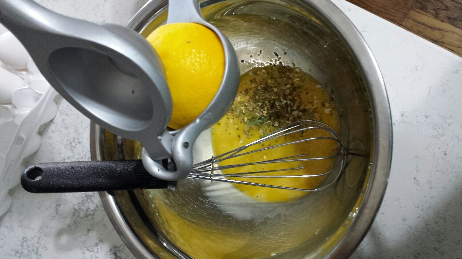 Place two egg yolks in a bowl. Add 1 tsp of South of France and the juice of half a lemon. Whisk until the eggs are doubled in size and slightly frothy.