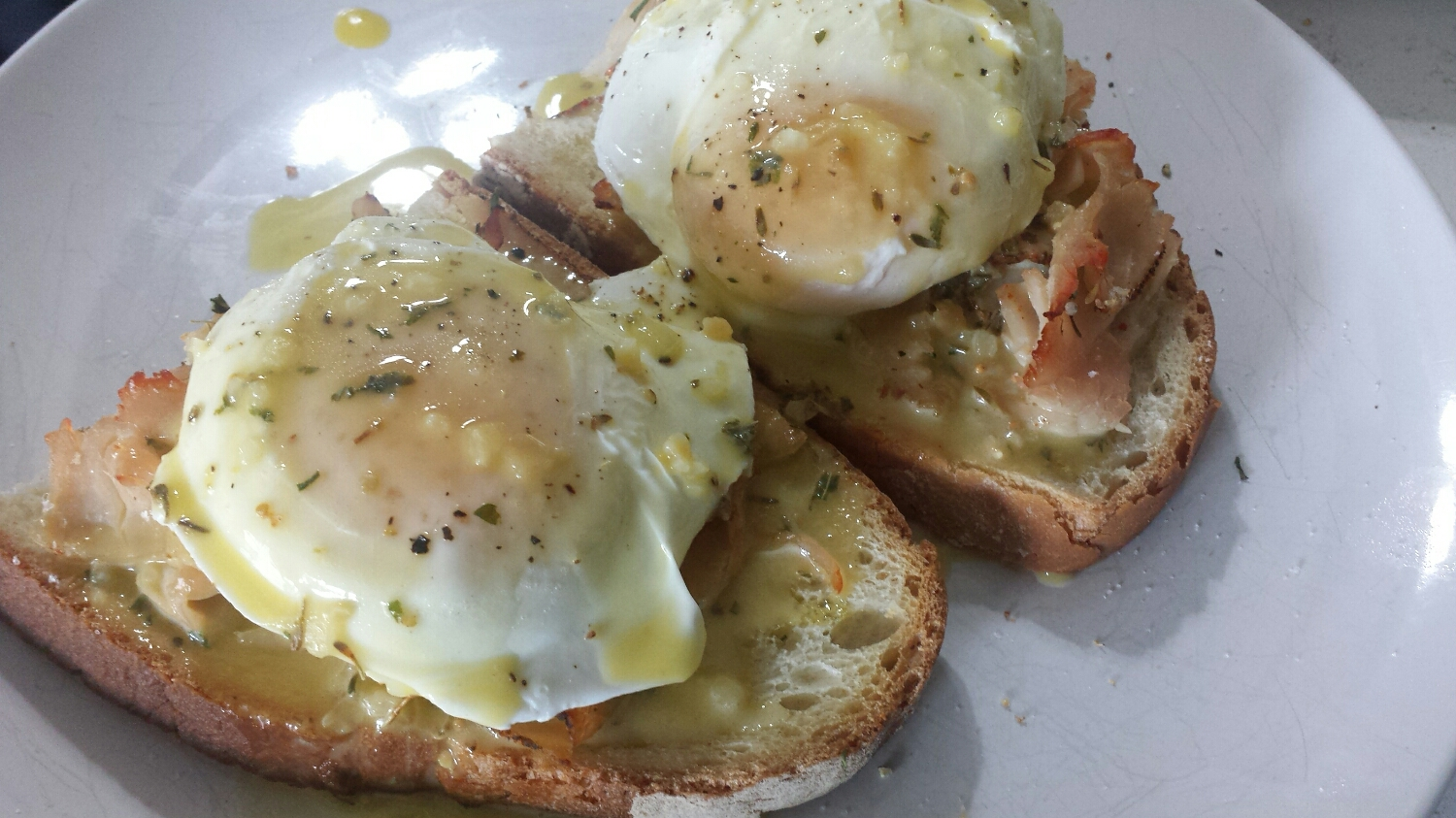 Remove the bread from the oven and place on a plate. Gently scoop the eggs from the saute pan and place on top of the bread/meat. Top the dish with hollandaise and, voila! Brunch is ready!