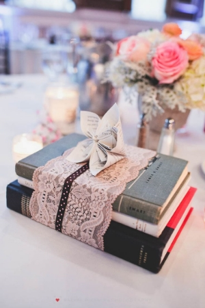 Sometimes, less is more.  As proven by these simple centerpieces of books wrapped with lace and a book page flower.