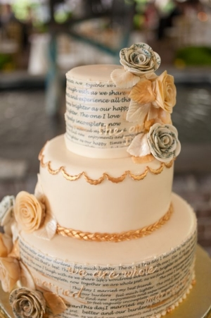 Of course, no book themed nuptial would be complete with a book themed adorable cake, right?!  Love the mix of page flowers and gold.