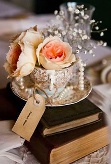 Seeing lots of antique books as centre pieces and decor around the reception!