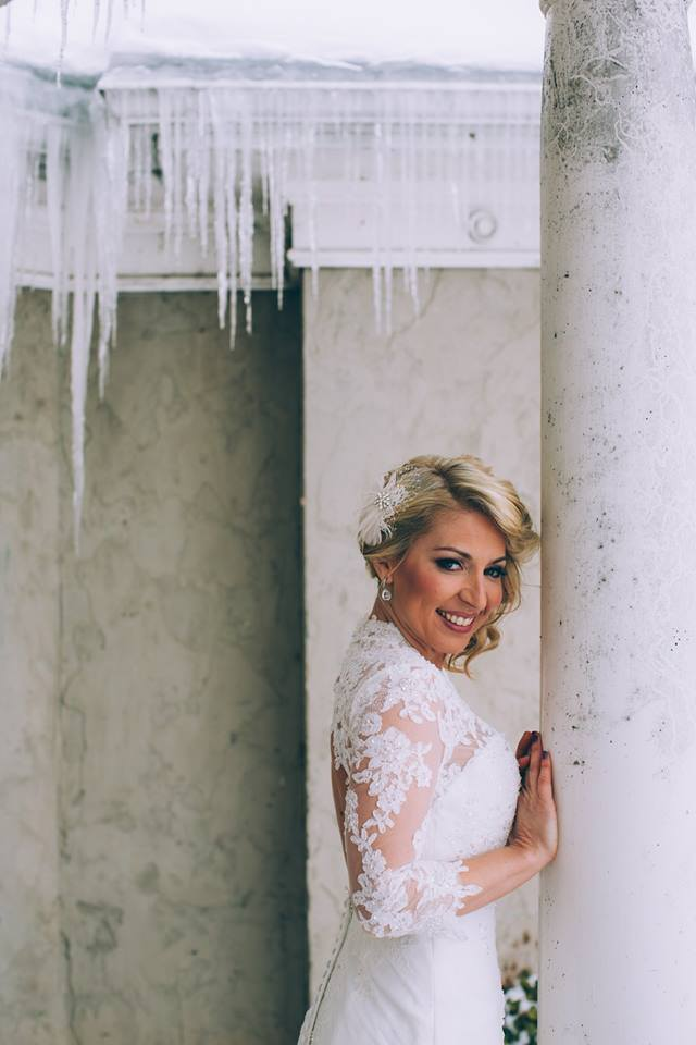 Once Upon A Time Weddings Bride added a lace jacket to her gown for the chilly weather.