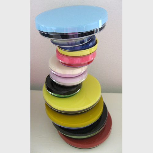 Molly Heron, Tottering, 2011, found latex paint on repurposed plastic petri dishes, 12.5_ x 3.5_@.jpg