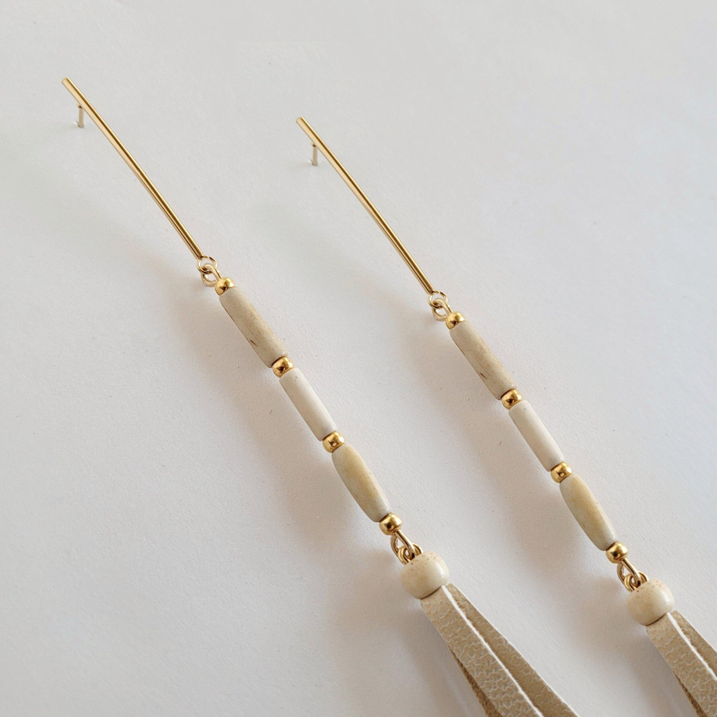 Long leather tassel trail earrings