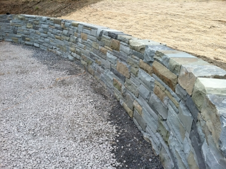 This is custom stonework at it's best. GreenScene installed this 50/50 bluestone block retaining wall (aka Llenroc) in Cayuga Heights , NY