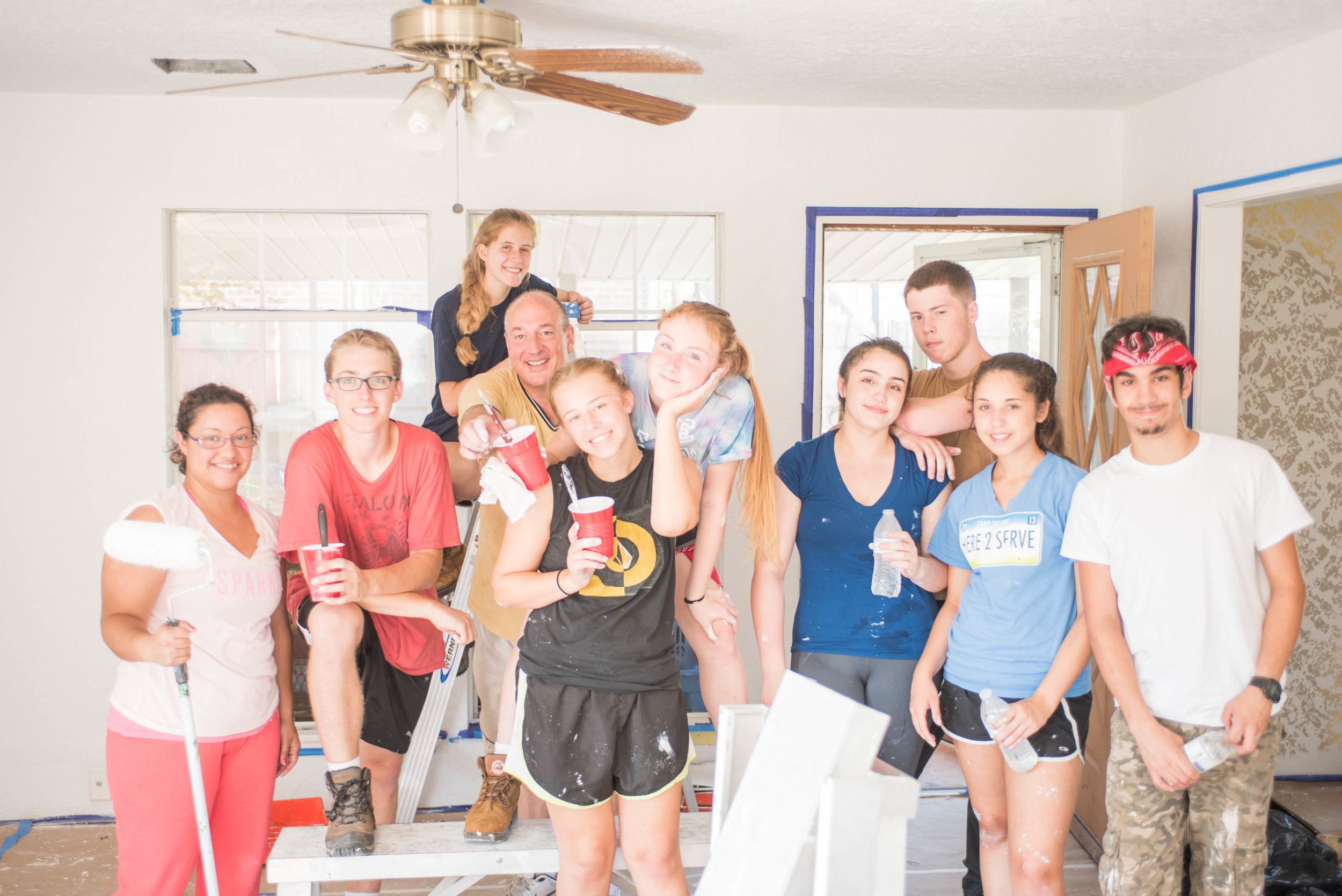 Serve More volunteers repair the interior of an Oklahoma City home after flood and tornado damage.