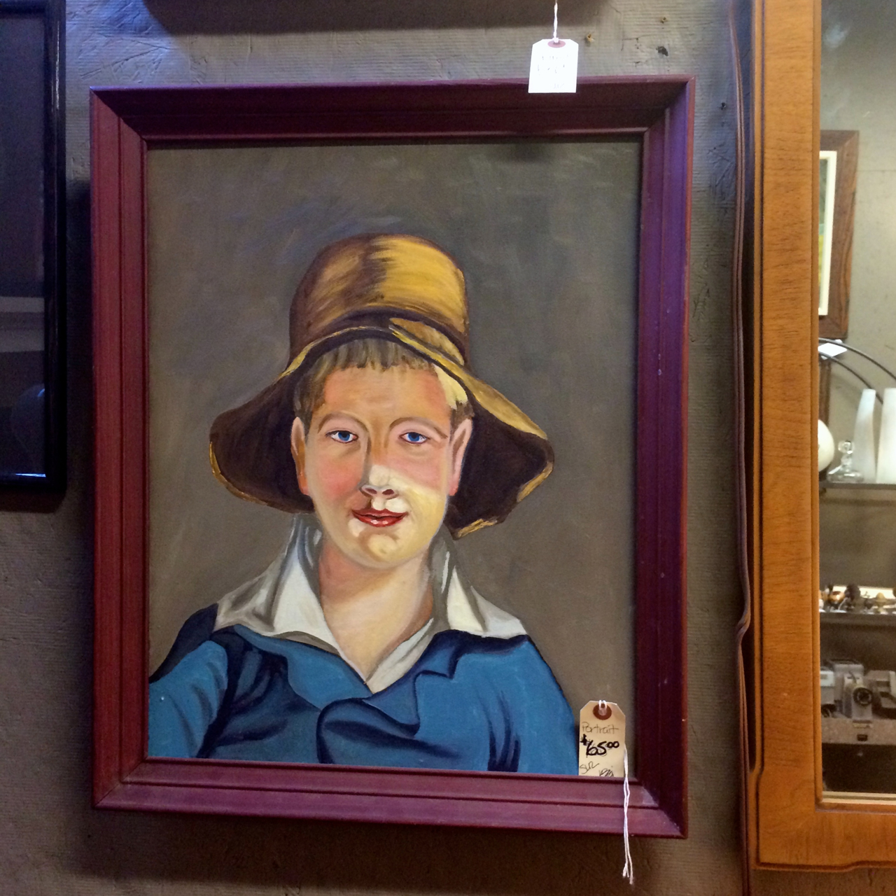 I have to say, this boy creeps me out a bit. That's terrible! But every time I return, I see him and am intrigued. I think he would make an interesting addition to a gallery wall.