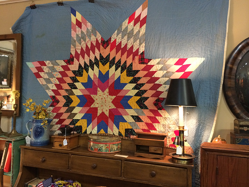 This was the first thing I saw when I turned the corner. I'm really into quilts, but usually not the traditional sort like this. But for some reason, the Americana feel and the colors and starburst design was really striking to me.