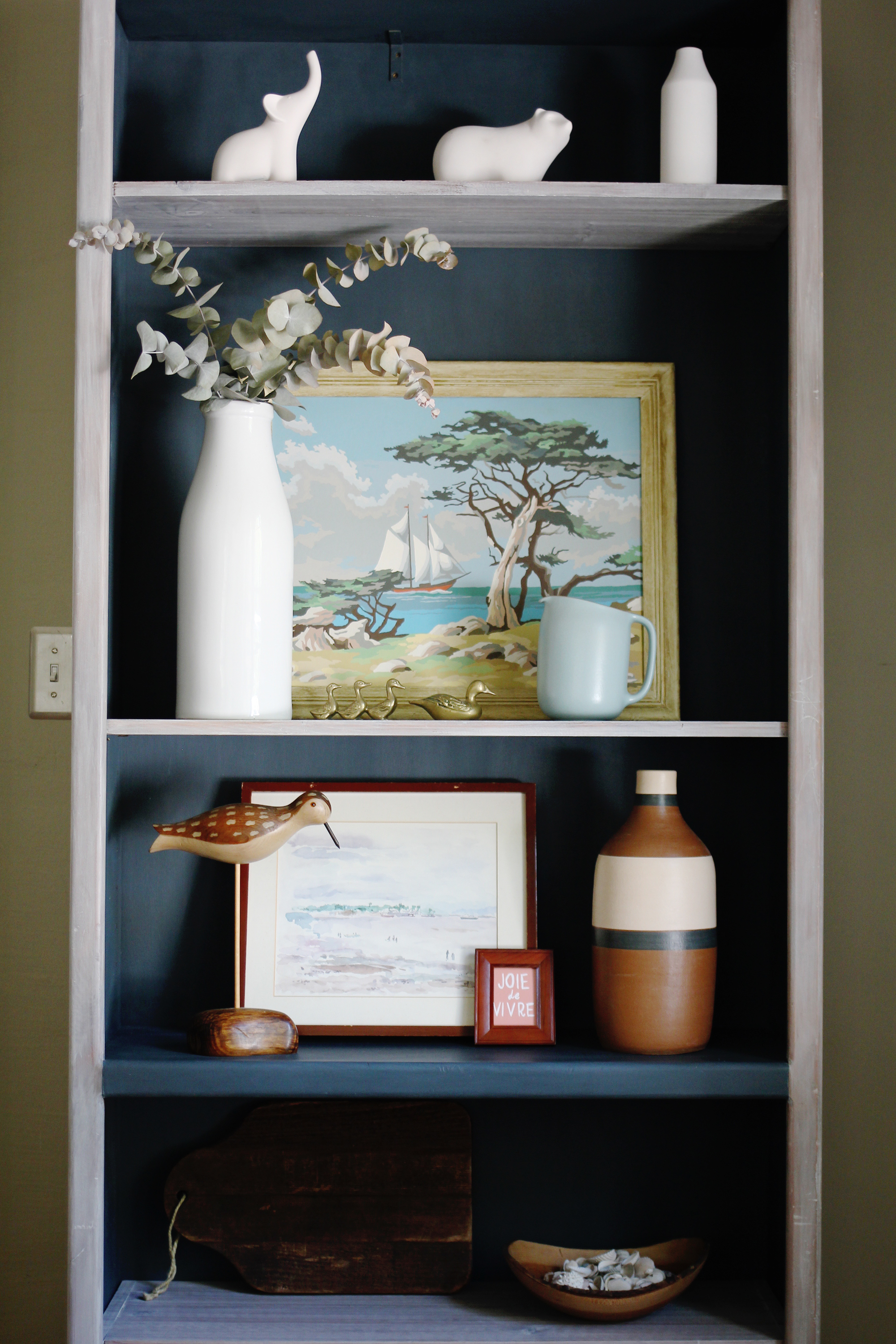 jo-torrijos-a-simpler-design-atlanta-painted-furniture-custom-furniture-annie-sloan-white-washed-bookcase-navy-6.jpg