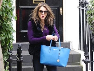 Elizabeth Hurley with a Michael Kors Jet Set Tote