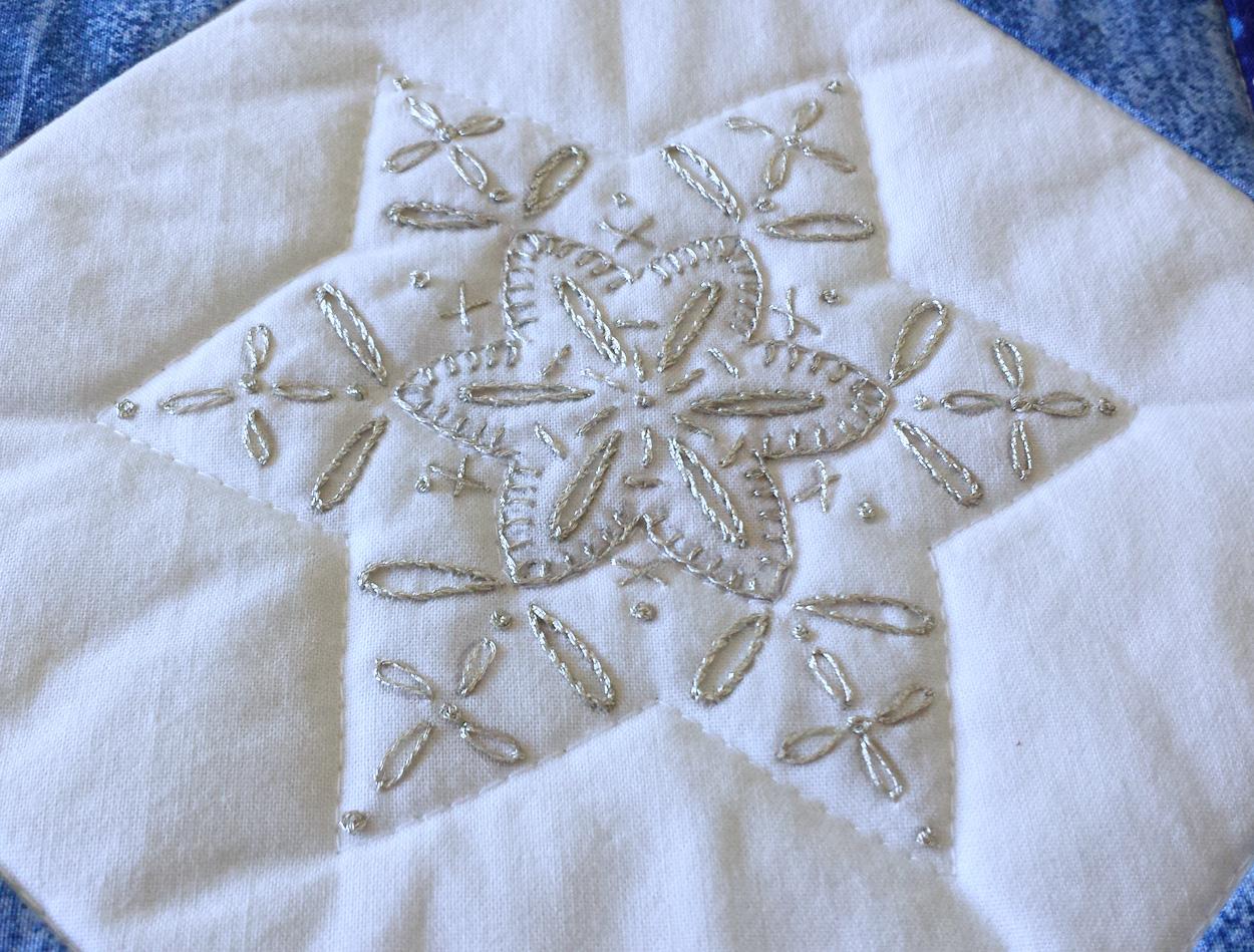 This snowflake was stitched using Cosmo Nishikiito #23