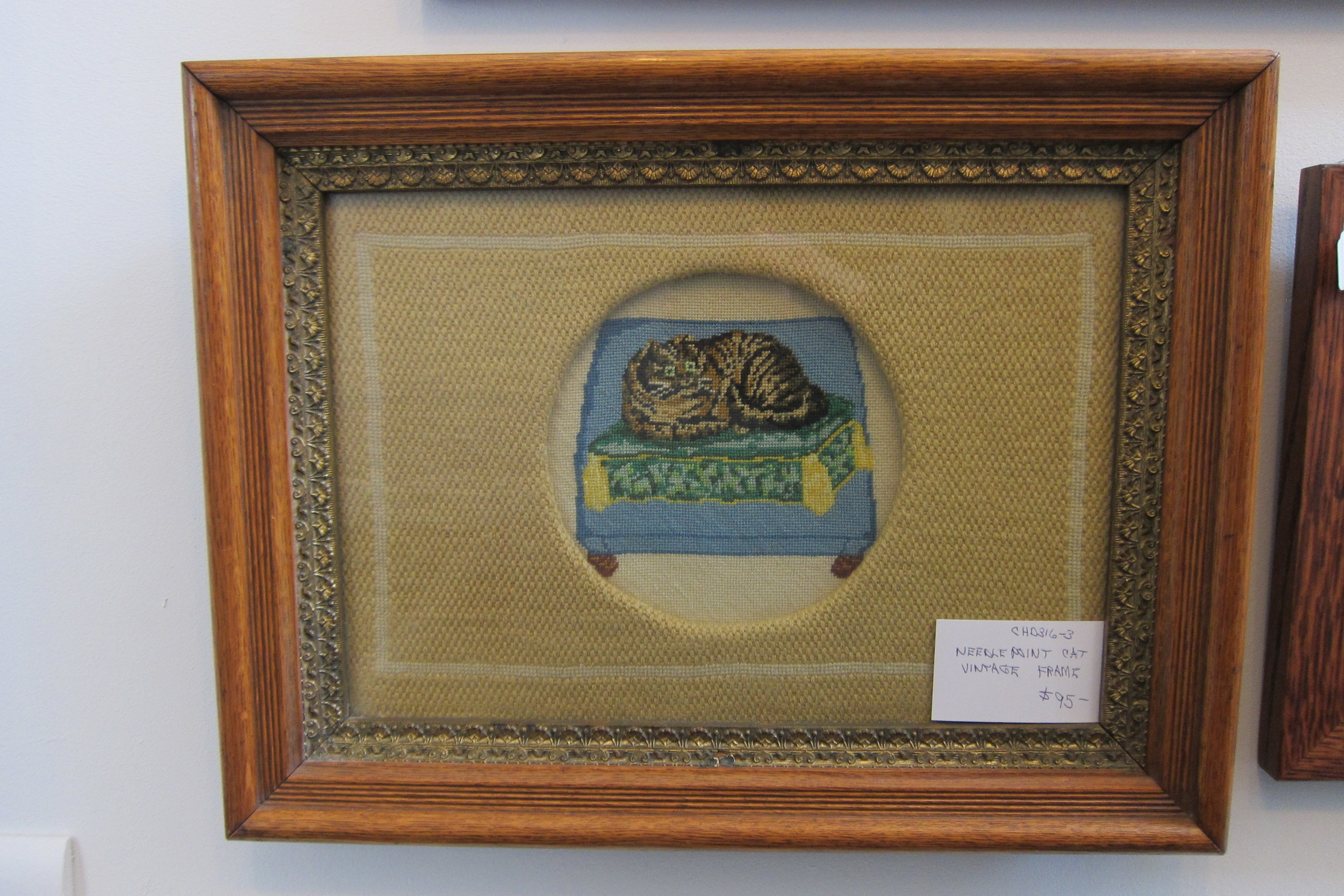 Picture #1: Needlepoint tabby cat, reclining on a cushion, in a vintage frame. Price: $95.