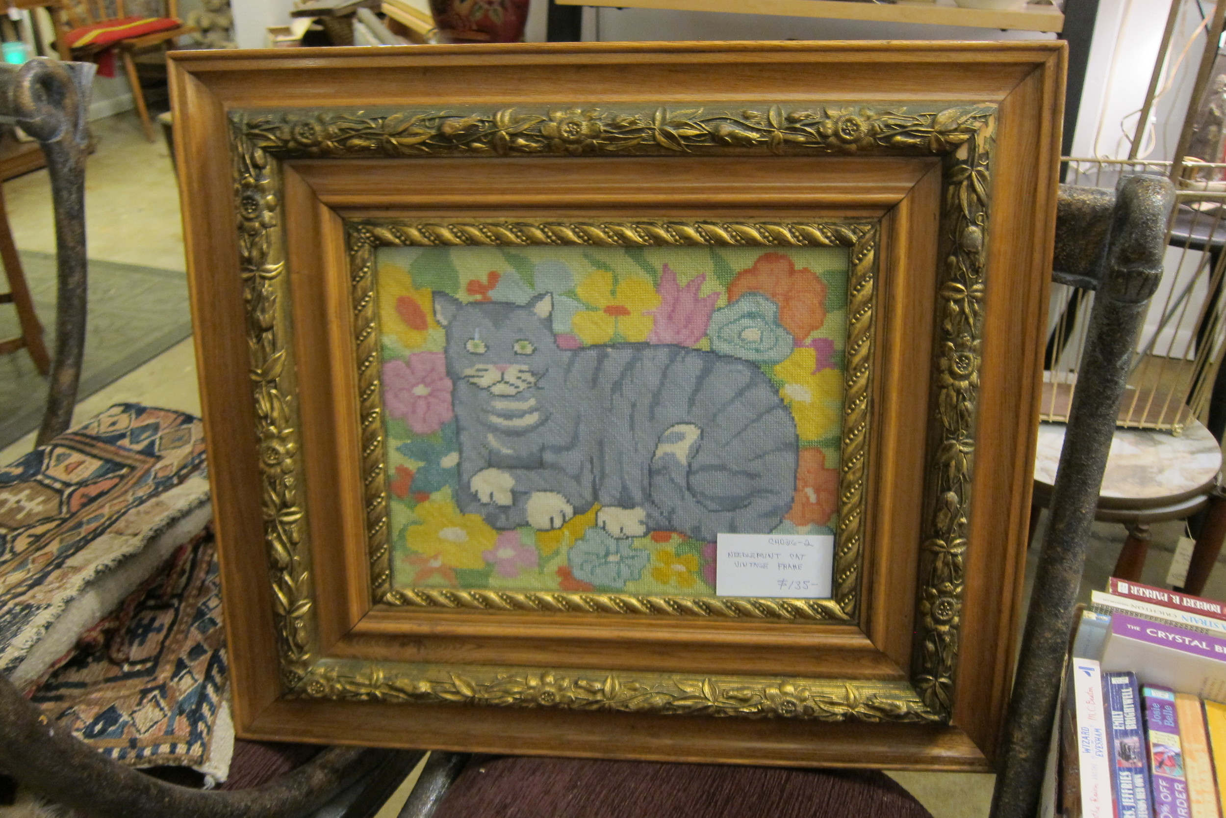 Picture #2: Needlepoint cat, surrounded by flowers, in a vintage frame.  Sold.