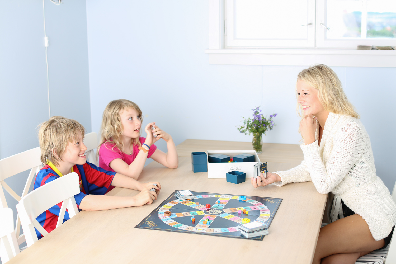 PLAY AND HAVE FUN IN REFERBISHED FACILITIES .Fun and games in a newly furnished living room. It isn't a great summer vacation without friendly feuds around a board game. The living room and dining room (picture) in the house are recently referbished with enough place for everyone to get together.
