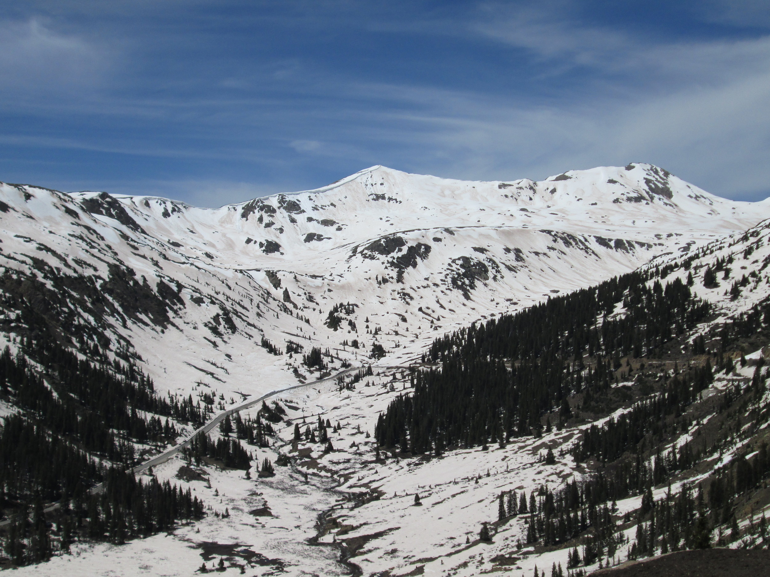 The early June date of this final CODOS circuit enabled a special visit to the recently opened Independence Pass, at 12,095'. Although patches of the Memorial Day weekend storm's clean snow remained, dust was rapidly re-emerging including heavy deposition of the most recent layer D8, the May 11, fawn-colored dust layer logged at Senator Beck Basin and observed extensively during this June 2-4 field circuit.