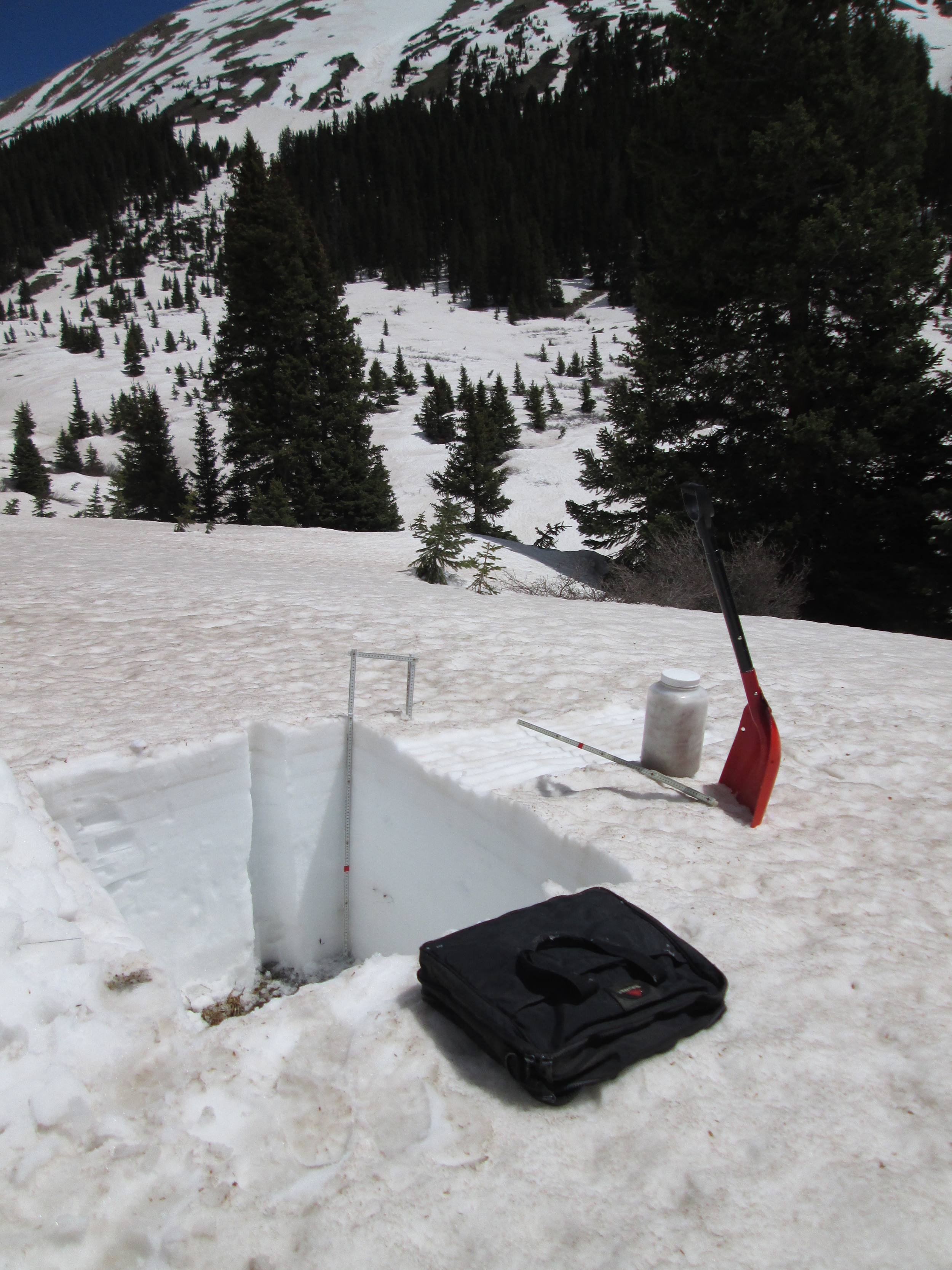 """Some 32"""" of """"very wet"""" snow remained at the CODOS snow profile site; the nearby Grizzly Peak Snotel was reporting just 21"""" at the time. Merged dust layers at the snowpack surface were extensively reducing snow albedo in the Loveland Pass locale, with only small remnants of the clean Memorial Day weekend snowfall remaining. An 'all layers merged' sample was collected."""