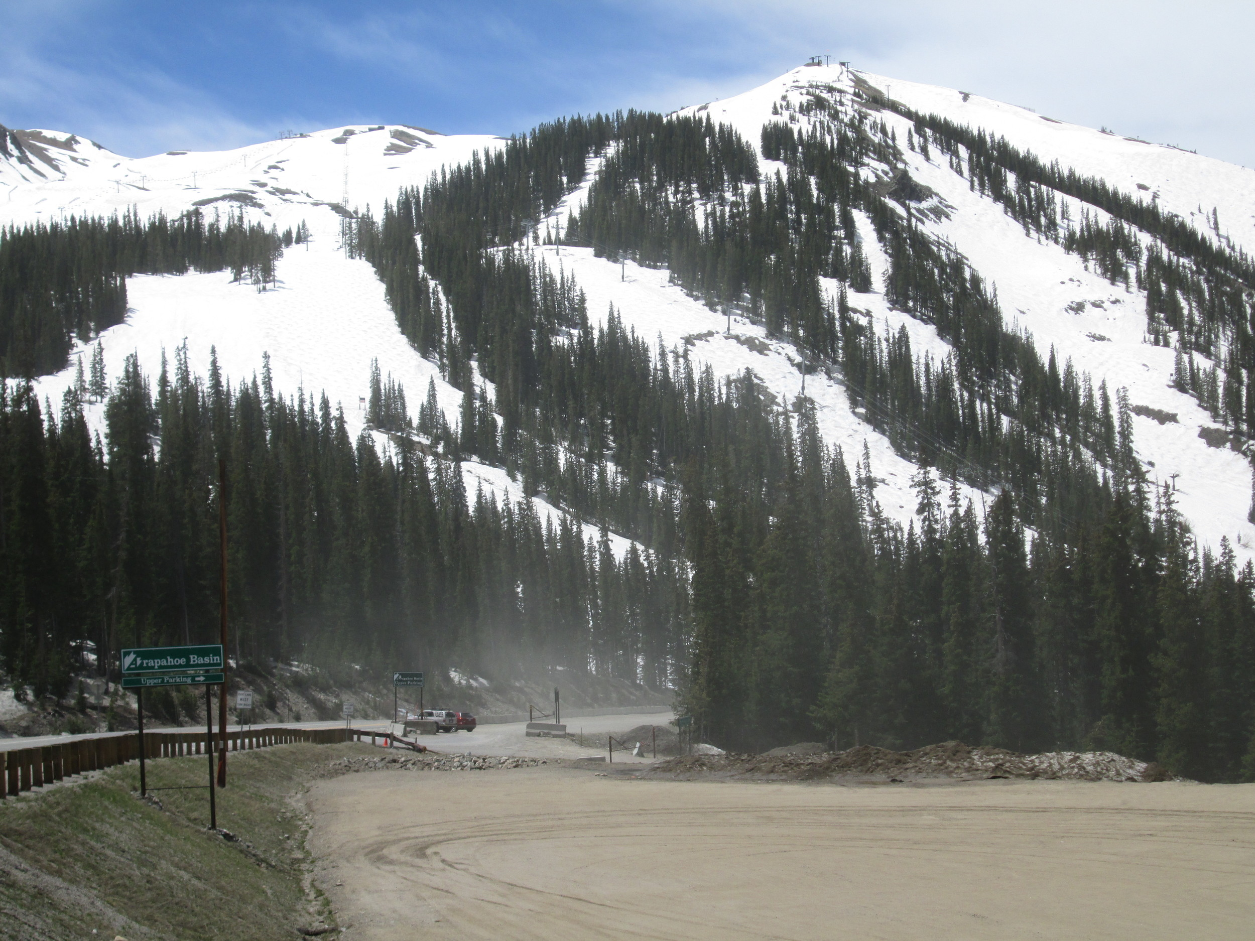 During this site visit, blustery winds occasionally produced blowing dust from the nearby Arapahoe Basin gravel parking lots. A sample of dirt was collected from the parking area, for comparison to the 'local' materials (i.e., the non-desert dust) found in the 'all layers merged' sample collected in spring 2013.