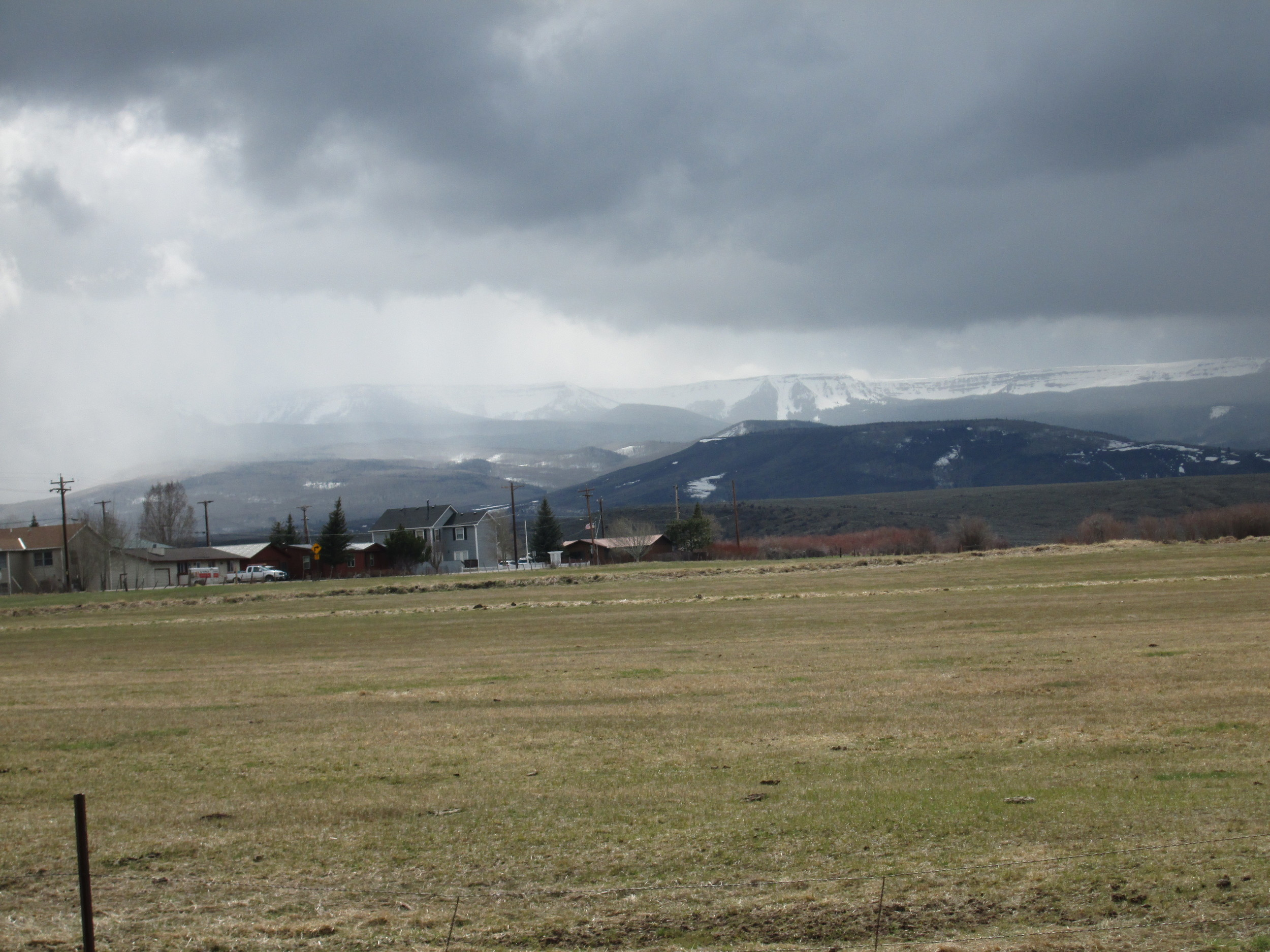 The Flat Tops eastern rim, seen behind the town of Yampa, was well covered in snow, while the valley floor was snow free and beginning to green.