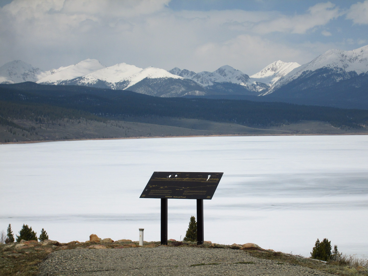 Taylor Reservoir still iced over on April 22, with virtually snow-free shoreline and adjacent south- and east-facing slopes.  The west slopes of the Sawatch Range, on the other hand, appeared heavily covered in the recent 'clean' new snow, down to and below treeline.