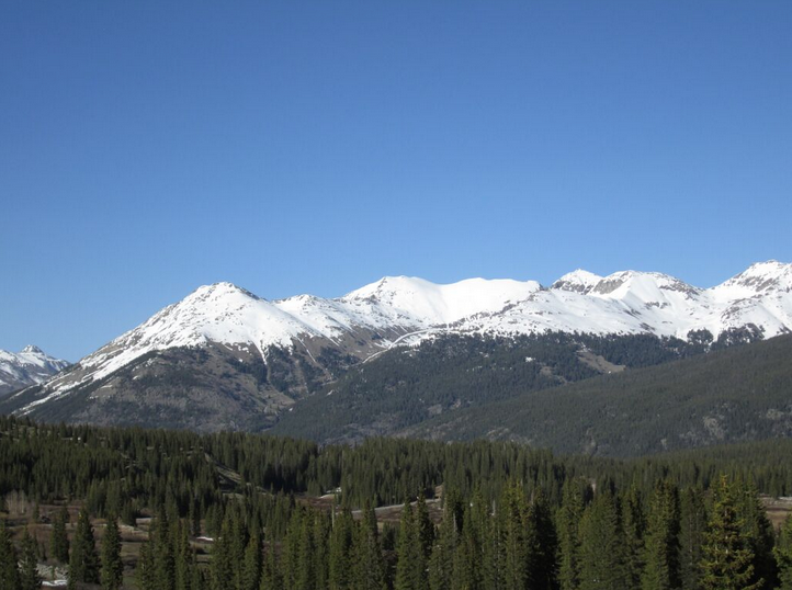 The view on June 2 looking northeast from Molas Pass of Kendall Mountain (13,338') on the left, immediately above Silverton, and assorted high terrain to the south of Kendall Mountain. Snowline was retreating above treeline on these southwest and west aspects.