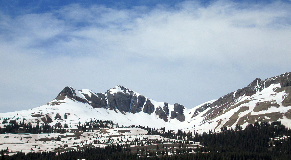 Photo taken  May 21 near   Molas  Pass. Dust on surface where there is still snow cover in foreground, less so higher up.