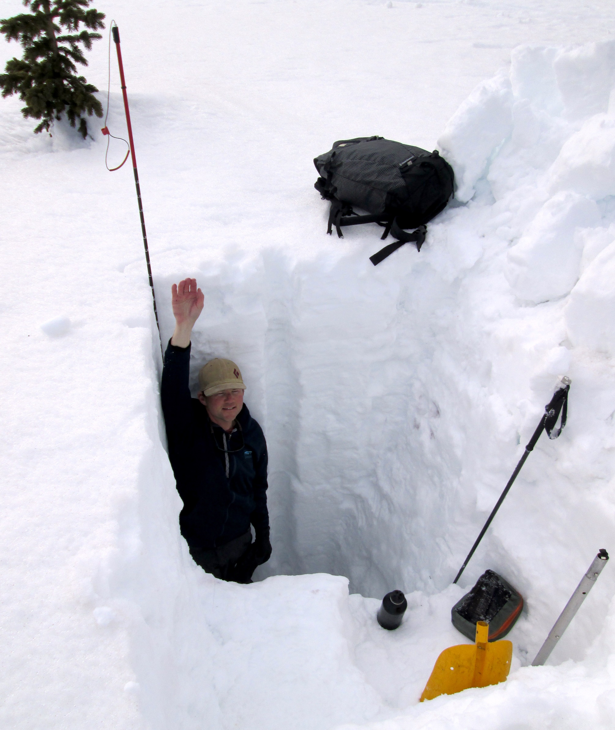 Andrew Temple showing off the 7.8' (2.37 m) snow pit at Wolf Creek Pass.