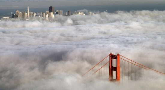 Fog around Golden Gate Bridge and city skyline