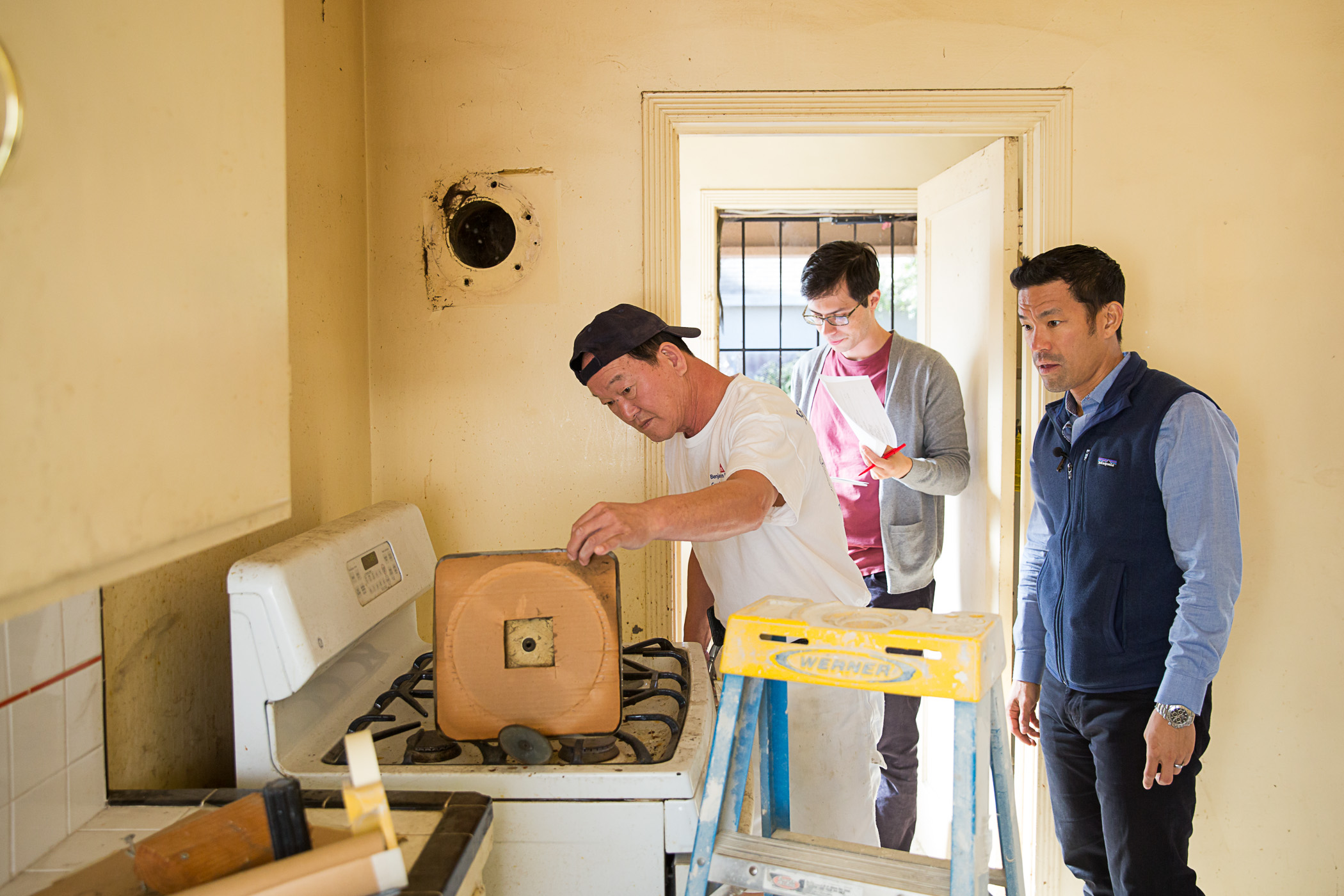 Kris and I go over kitchen repairs with the handyman.